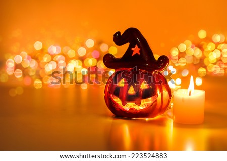 Halloween pumpkin with candlelight and bokeh background - stock photo