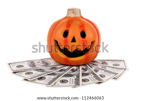 Halloween pumpkin with money isolated on white background - stock photo