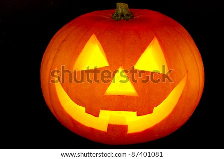 Halloween pumpkin with scary face isolated on black - stock photo