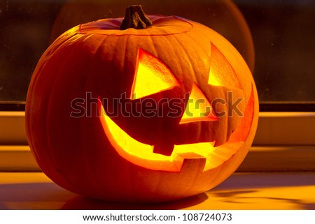 Halloween pumpkin with scary on the window at night - stock photo