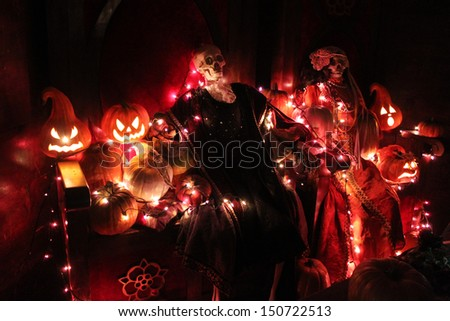 Halloween pumpkins and skeletons - stock photo
