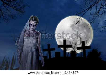 Halloween scene with creepy zombie bride on the dark night at graveyard - stock photo