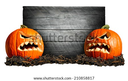 Halloween sign with two scary pumpkins in front of an old blank weathered wood banner as a concept for a creepy advertisement and marketing announcement for a harvest time party. - stock photo