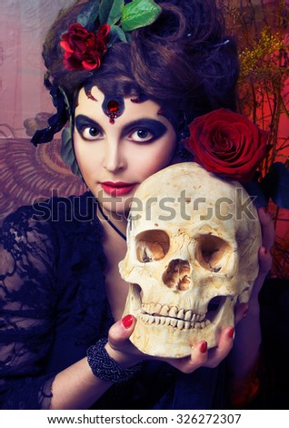 Halloween. Spanish woman. Young woman in dramatic artistic image with rose's and skull - stock photo