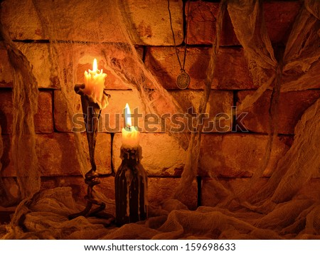 Halloween still life with two burning candles on stone background - stock photo