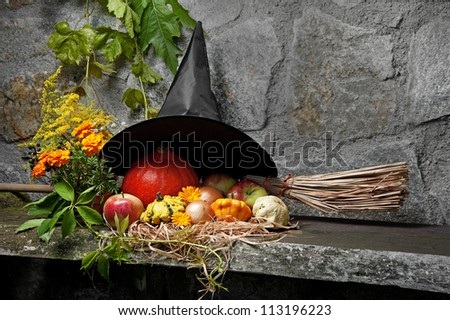 halloween still life with witch hat and broom - stock photo