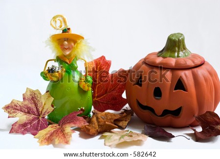 halloween witch and pumpkin with maple leaves on white background - stock photo