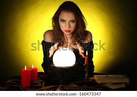 Halloween witch on dark yellow background - stock photo