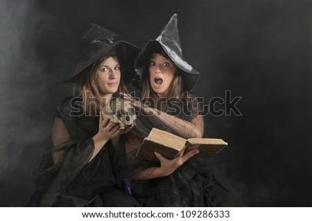 halloween witch pronouncing a magic formula - stock photo
