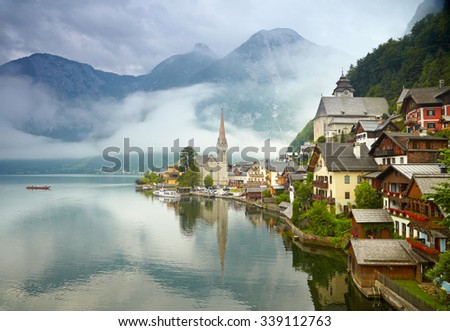 Hallstatt mountain village. Foggy morning - stock photo