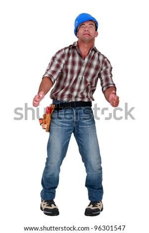 Hallucinating tradesman - stock photo