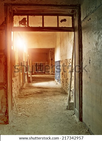 hallway in an abandoned industrial complex - stock photo