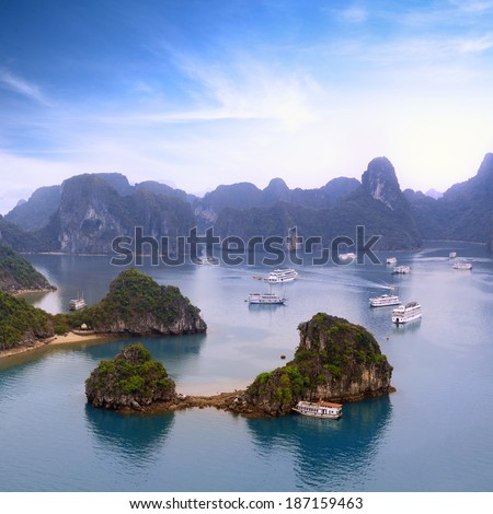 Halong Bay Vietnam panorama. Beautiful panoramic view of Ha Long bay with many islands and mountains in ocean water of southeast sea near Hanoi. Famous landmark and popular tourist travel destination  - stock photo