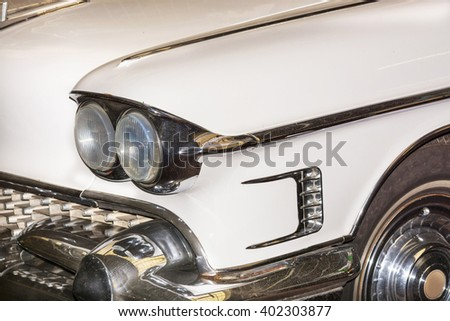 HALTERN, NRW, GERMANY - FEBRUARY 1, 2016:Detail US Car of the 50s, headlight of a classic car at an exhibition. - stock photo