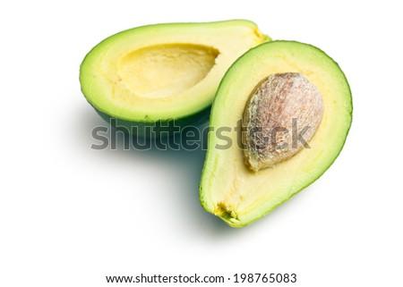 halved avocados on white background - stock photo