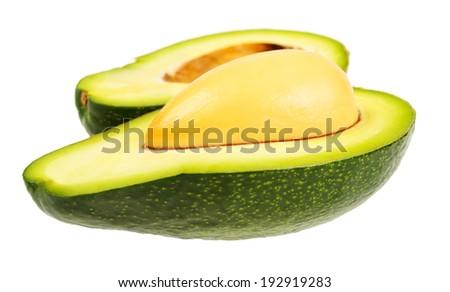 Halved ripe avocado. Isolated on white background. - stock photo