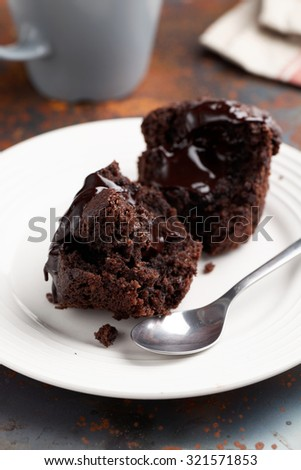 Halves of chocolate muffin on a rustic table - stock photo