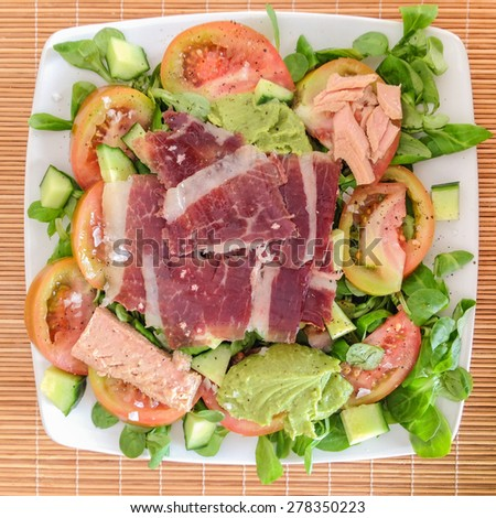 Ham and Tuna salad on a white plate from above. - stock photo