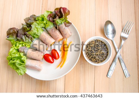 Ham roll salad with lettuce, tomato, egg and sesame sauce, clean food and fresh vegetable. - stock photo