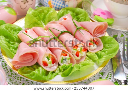 ham rolls stuffed with cheese and vegetables for easter breakfast - stock photo