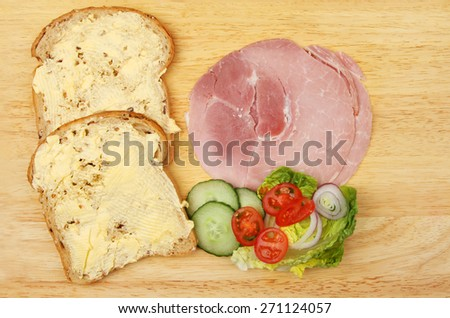 Ham salad sandwich ingredients on a wooden board - stock photo