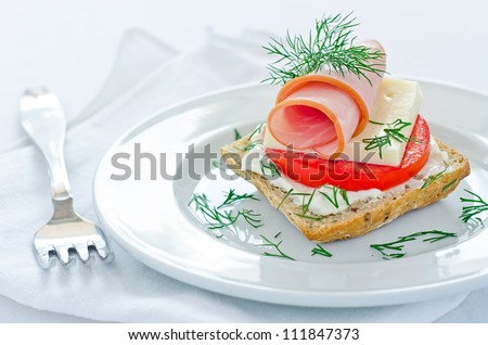 Ham sandwich with bread tomato and cheese - stock photo