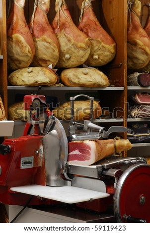 Ham slicer in a warehouse. - stock photo