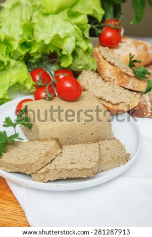 Ham with vegetables on white plate - stock photo