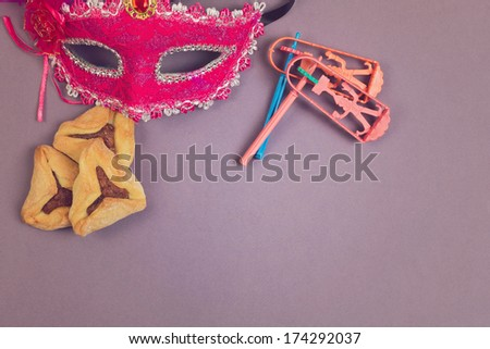 Hamantaschen cookies, grogger and carnival mask - stock photo