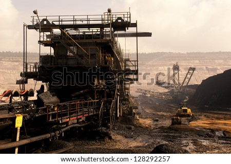 HAMBACH, GERMANY - SEPTEMBER 1: A conveyor belt for transporting lignite (brown-coal) in one of the world's deepest open-pit mines in Hambach on September 1, 2010 - stock photo
