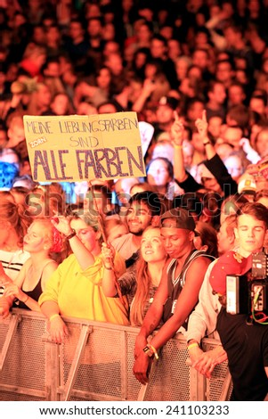 HAMBURG, GERMANY - AUGUST 15, 2014: Concert crowd during a show of German DJ and producer ALLE FARBEN at MS Dockville Festival on August 15, 2014 in Hamburg. - stock photo