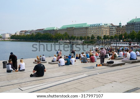 HAMBURG, GERMANY - AUGUST 14, 2015: People resting to Binnenalster Lake, Binnenalster or Inner Alster Lake is one of two artificial lakes within the city limits of Hamburg - stock photo
