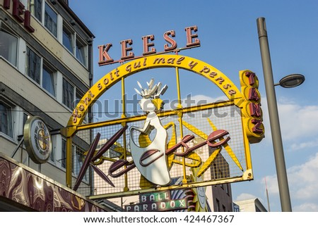 HAMBURG, GERMANY - JULY 25, 2012: famous sign Cafe Keese at the Reeperbahn in Hamburg. The cafe was founded by Mr. Keese in 1948. - stock photo