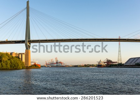 HAMBURG, GERMANY - JUNE 03. Koehlbrand bridge in the harbor of Hamburg on June 03, 2015. The bridge opened 1974 is an important Cable-stayed bridge and a landmark in the port. The bridge is 315m high - stock photo