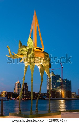 "HAMBURG, GERMANY - JUNE 10. The Dali monument ""Space Elephant"", in front of the Elbe Philharmonic Hall in the harbor of Hamburg on June 10, 2015. Dali was a leading representatives of surrealism.  - stock photo"