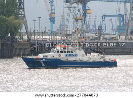 Hamburg, Germany - May 09, 2015: A police boat patrols on the Elbe during Port Birthday Hamburg. Each year the City of Hamburg celebrates the birthday of its harbour.  - stock photo