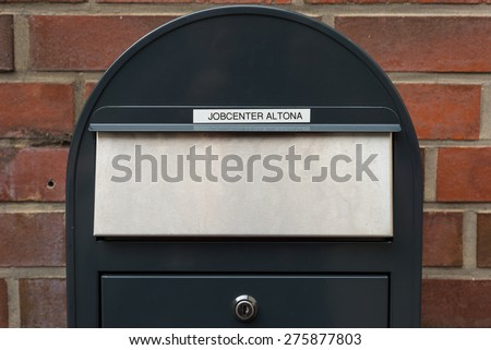 HAMBURG, GERMANY - MAY 03. Mail delivery for the employment office after business hours in Hamburg on May 03, 2015. Lettering at letter box on the wall of the Job Center Hamburg Altona - stock photo