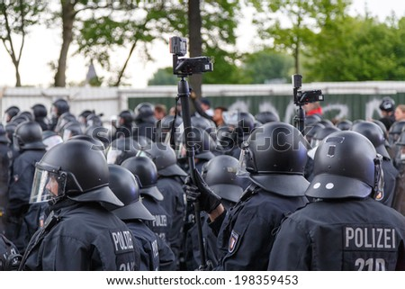 HAMBURG, GERMANY - MAY 1, 2014: police records protesters during the annual May Day demonstration in Hamburg, Germany on May 1, 2014. - stock photo