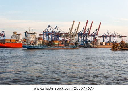 HAMBURG, GERMANY - MAY 04. Transshipment of goods on container terminal Burchardkai on May 04, 2015. Movement of goods and container shipment is a significant economic factor for German companies - stock photo