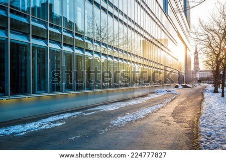 hamburg modern architecture, glass facade with sunset - stock photo