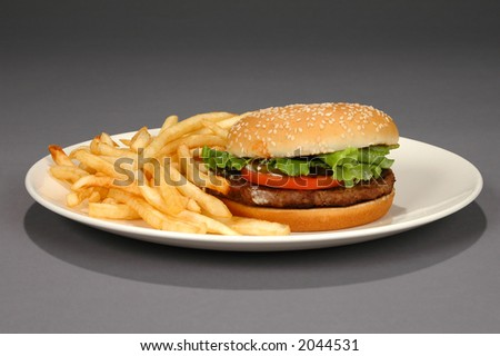 Hamburger and fries on a neutral background (With Clipping Path) - stock photo