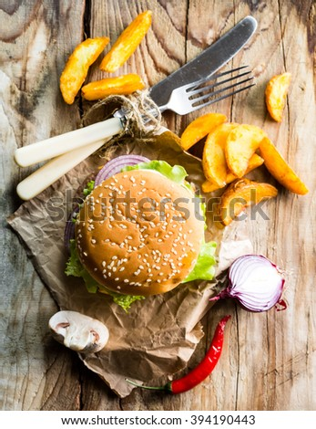 hamburger and fries on a wooden table. view from above - stock photo