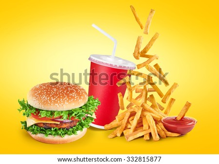 Hamburger, fried potatoes, ketchup and paper cup. Comercial high resolution fast food. - stock photo