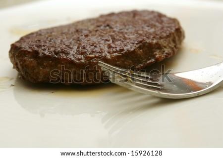 Hamburger on a white dish - stock photo