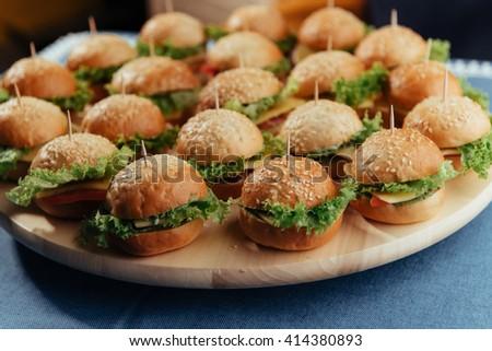 Hamburger on wood table. Home made burger. Fastfood meal. Pub burger. Delicious Hamburger. Gourmet hamburger.  - stock photo