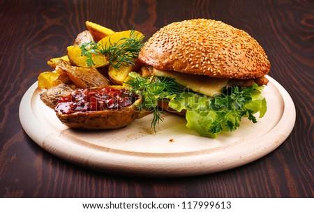 hamburger on wooden board - stock photo