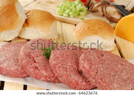 Hamburger patties and buns - stock photo