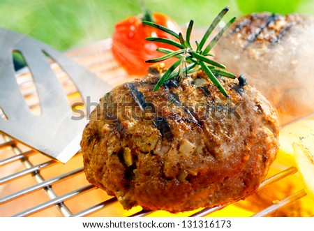 Hamburger patty grilling on the barbecue isolated on - stock photo