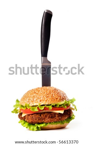 Hamburger pinned with knife isolated over white - stock photo