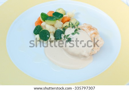Hamburger with mustard sauce and crispy vegetables - stock photo